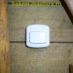 Кнопка звонка у входной двери