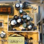 Поврежденные конденсаторы платы блока питания телевизора Philips на шасси LT41.1E